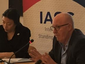 A photo of Jamie McGoldrick, Humanitarian Coordinator in the Occupied Palestinian Territory briefing and Wendy Cue, Senior Humanitarian Coordinator, Inter-Agency Standing Committee chairing the meeting. Background banner of the IASC.