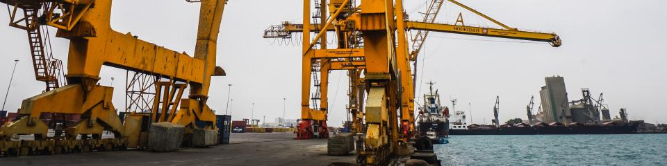 A photo showing damaged cranes on a dockside in Yemen, which have been out of service since 2015.